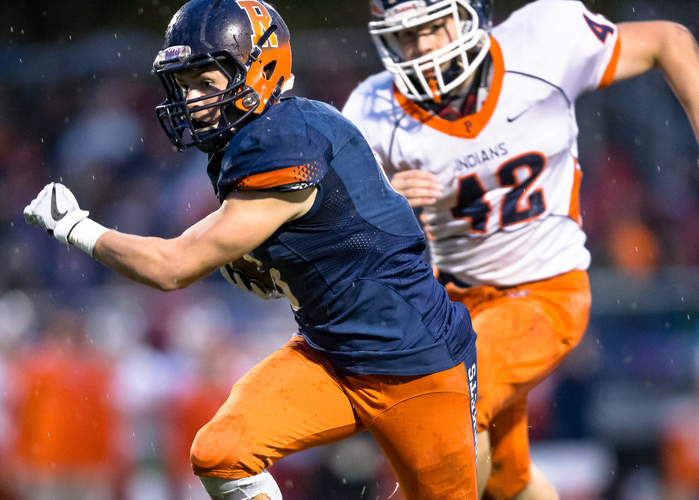 Rochester's Cade Eddington (6) sheds tackles on his way to the end zone for a touchdown against Pontiac in the first half in the second round of the Class 4A playoffs at Rochester High School, Saturday, Nov. 3, 2018, in Rochester, Ill. [Justin L. Fowler/The State Journal-Register]