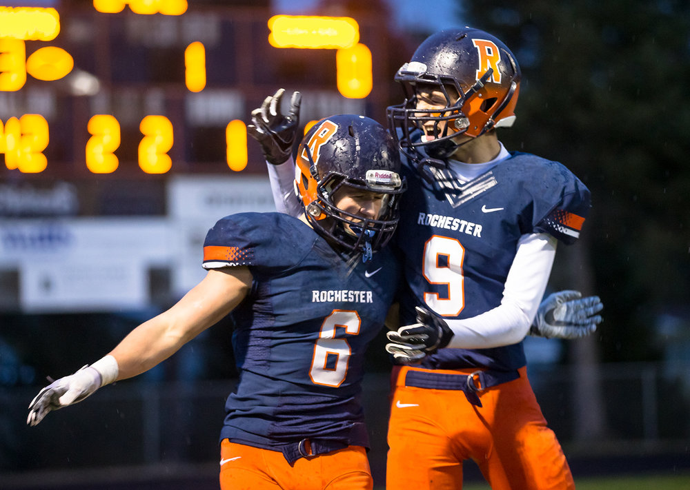 Rochester's Cade Eddington (6) celebrates his touchdown with Rochester's Clayton Cornett (9) as the Rockets take on Pontiac in the first half in the second round of the Class 4A playoffs at Rochester High School, Saturday, Nov. 3, 2018, in Rochester, Ill. [Justin L. Fowler/The State Journal-Register]