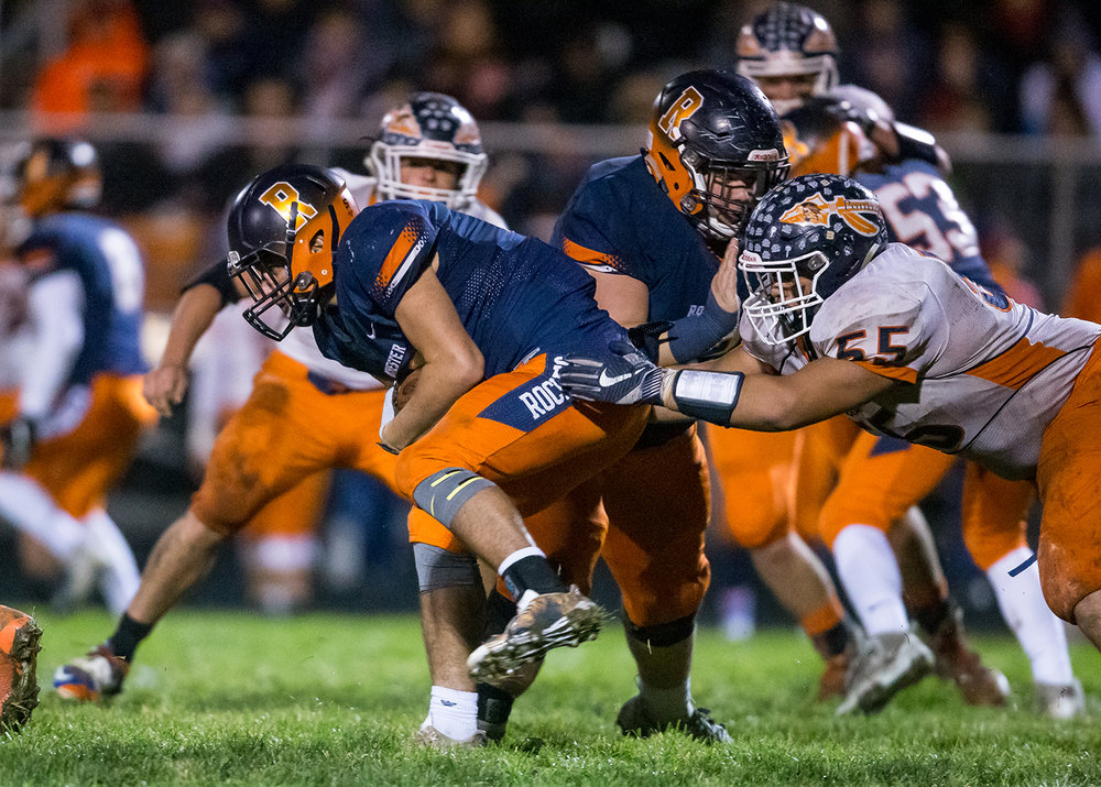 Rochester's Zach Gleeson (30) bursts through the Pontiac defense on a rush in the second half in the second round of the Class 4A playoffs at Rochester High School, Saturday, Nov. 3, 2018, in Rochester, Ill. [Justin L. Fowler/The State Journal-Register]