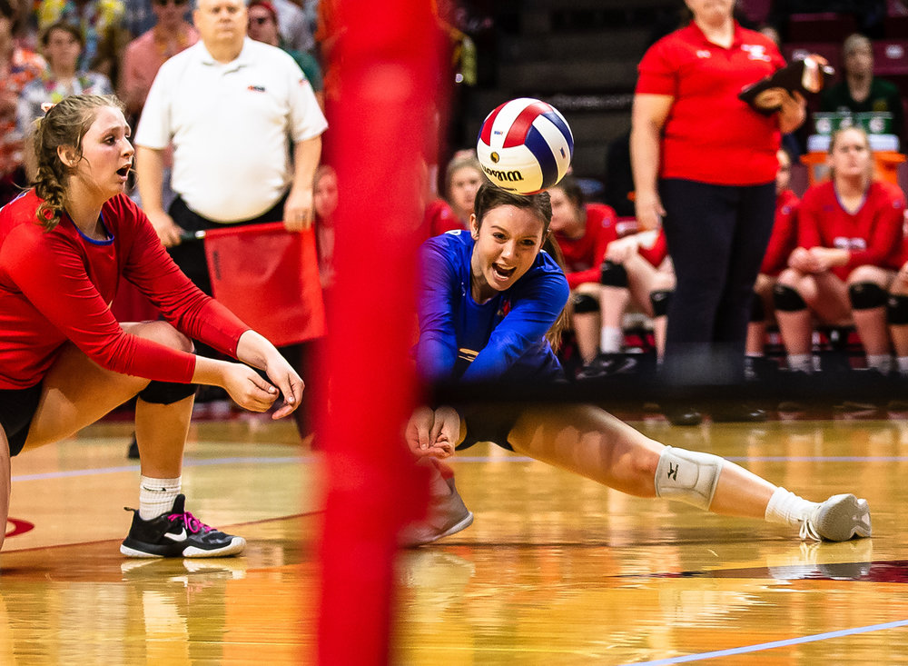 Pleasant Plains' MacKenzie Houser (3) slides in to make a dig against Champaign St. Thomas More during the Class 2A IHSA Volleyball State Final Tournament semifinals at Redbird Arena, Friday, Nov. 9, 2018, in Normal, Ill. [Justin L. Fowler/The State Journal-Register]