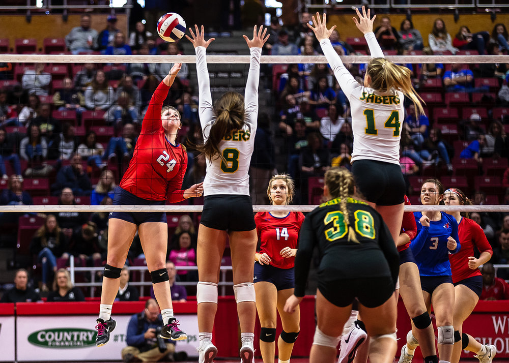 Pleasant Plains' McKenzie Smith (24) sends an attack over the net against Champaign St. Thomas More during the Class 2A IHSA Volleyball State Final Tournament semifinals at Redbird Arena, Friday, Nov. 9, 2018, in Normal, Ill. [Justin L. Fowler/The State Journal-Register]