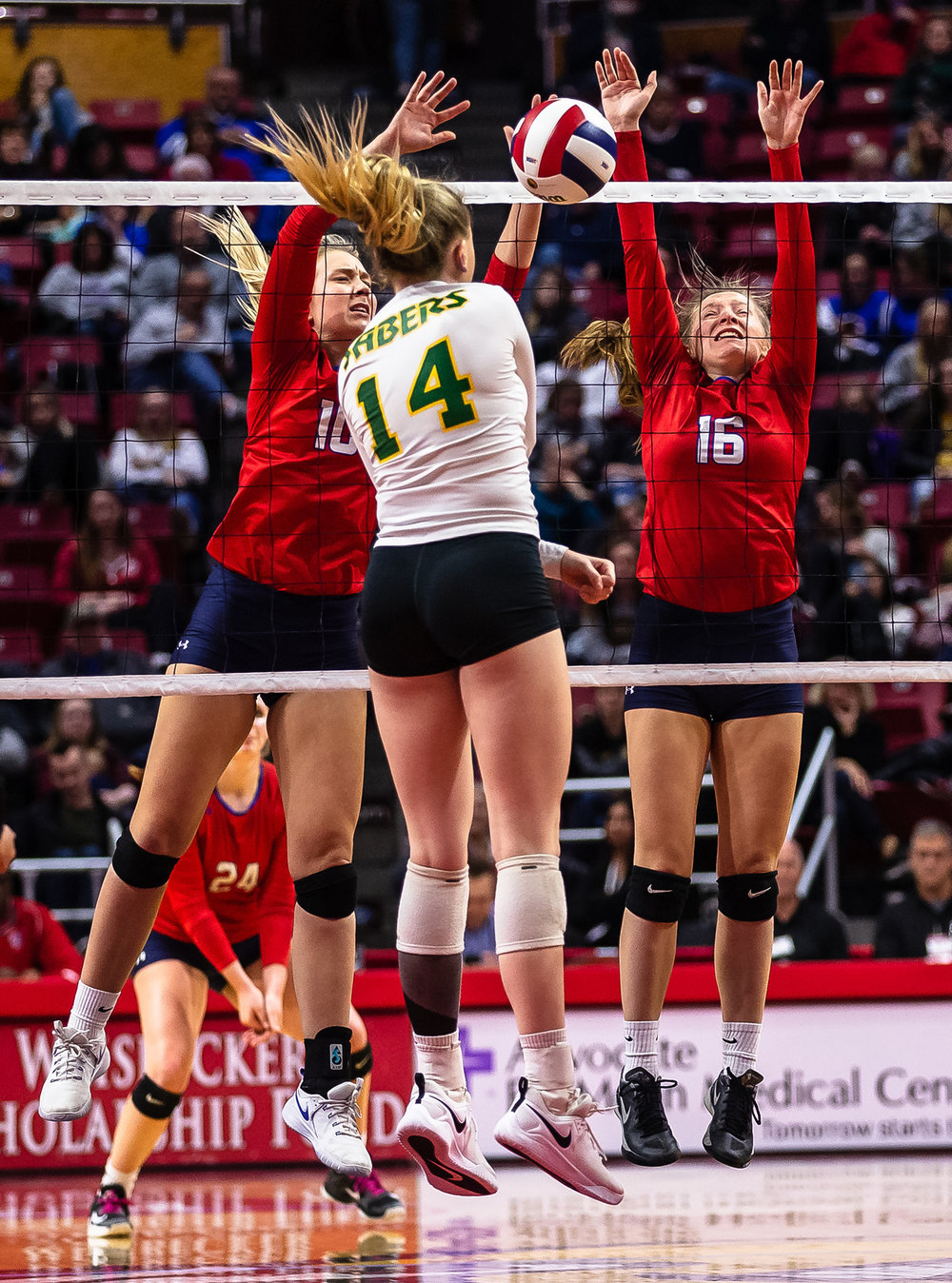 Pleasant Plains' Allie Edwards (10) joins in with Pleasant Plains' Macy Kanllakan (16) to block an attack from Champaign St. Thomas More's Allie Trame (14) during the Class 2A IHSA Volleyball State Final Tournament semifinals at Redbird Arena, Friday, Nov. 9, 2018, in Normal, Ill. [Justin L. Fowler/The State Journal-Register]