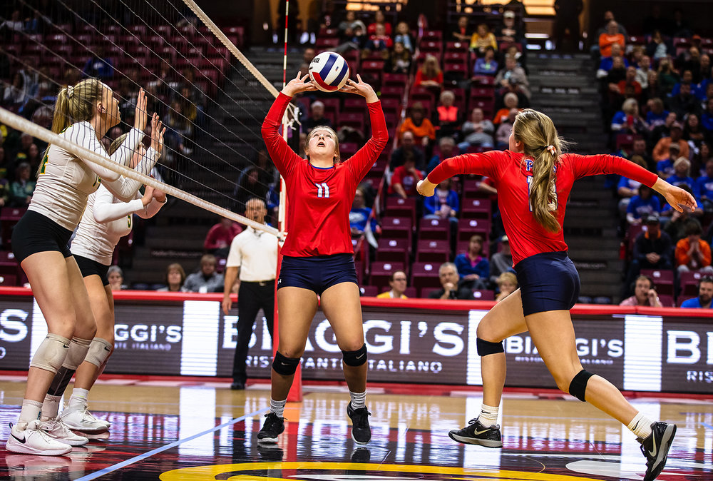 Pleasant Plains' Emily Long (11) on the set for Pleasant Plains' Anna Kanllakan (18) as the Cardinals take on Champaign St. Thomas More during the Class 2A IHSA Volleyball State Final Tournament semifinals at Redbird Arena, Friday, Nov. 9, 2018, in Normal, Ill. [Justin L. Fowler/The State Journal-Register]