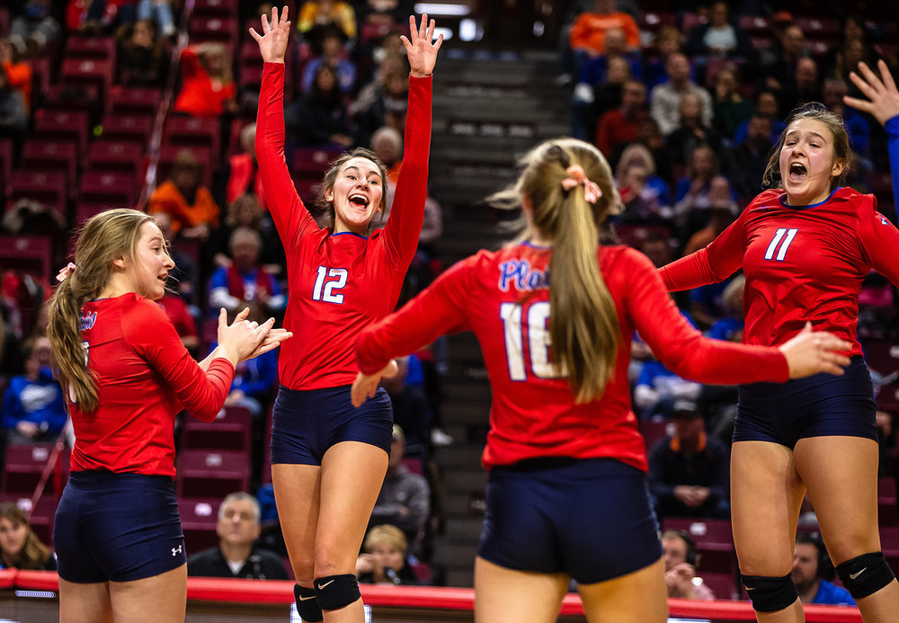 Pleasant Plains' Maddie Reiser (12) celebrates a Cardinals point against Champaign St. Thomas More during the Class 2A IHSA Volleyball State Final Tournament semifinals at Redbird Arena, Friday, Nov. 9, 2018, in Normal, Ill. [Justin L. Fowler/The State Journal-Register]