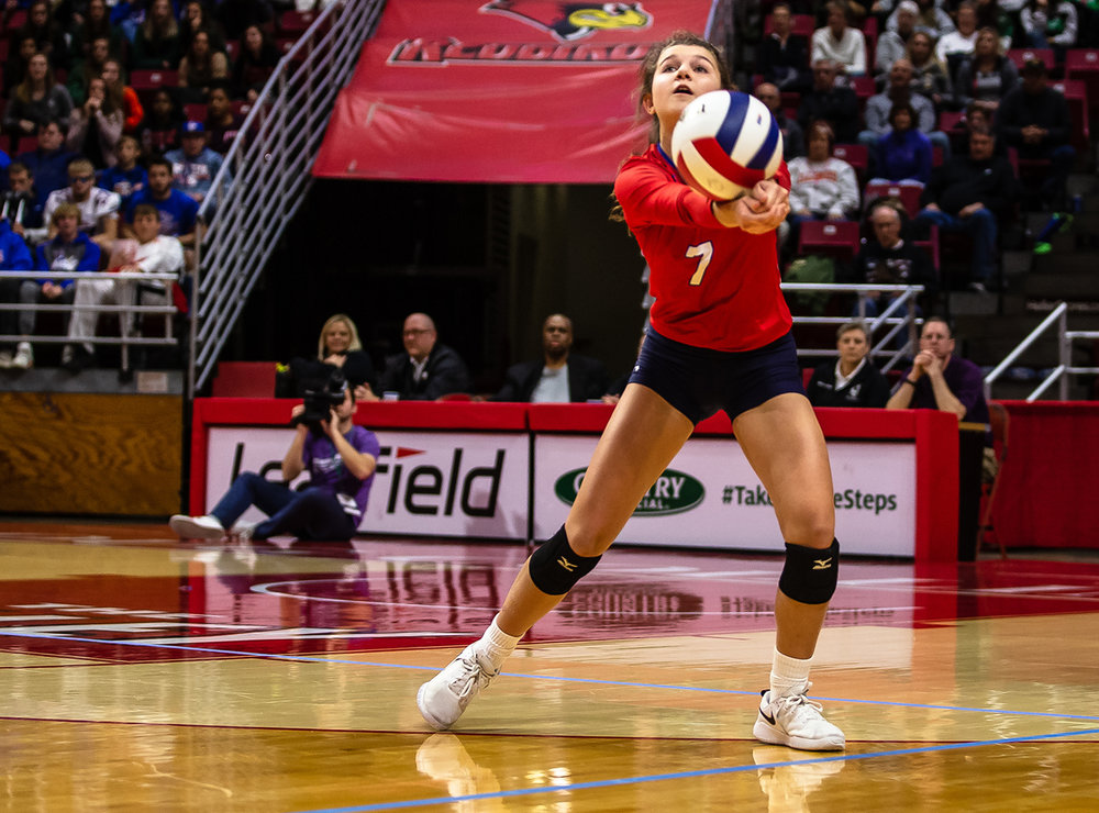 Pleasant Plains' Ali Fraase (7) digs out an attack from Champaign St. Thomas More during the Class 2A IHSA Volleyball State Final Tournament semifinals at Redbird Arena, Friday, Nov. 9, 2018, in Normal, Ill. [Justin L. Fowler/The State Journal-Register]