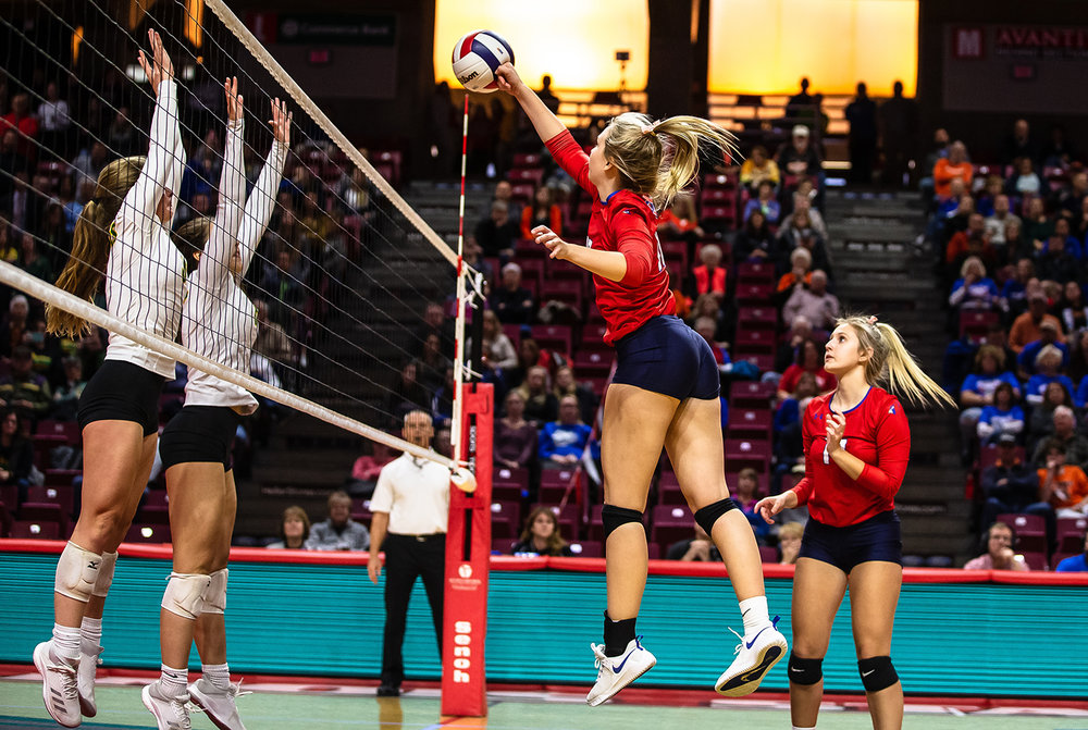 Pleasant Plains' Allie Edwards (10) with the game winning attack over the net to defeat Champaign St. Thomas More and send the Cardinals in the championship game during the Class 2A IHSA Volleyball State Final Tournament semifinals at Redbird Arena, Friday, Nov. 9, 2018, in Normal, Ill. [Justin L. Fowler/The State Journal-Register]