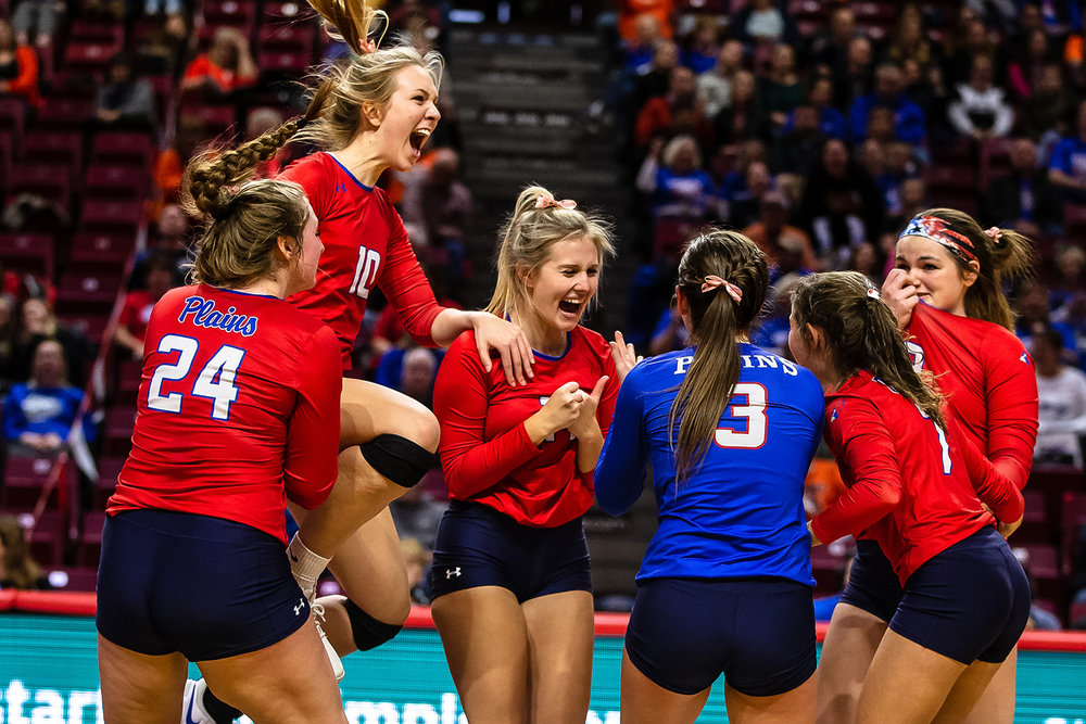 Pleasant Plains' Allie Edwards (10) leaps up as she celebrates with her teammates after the Cardinals defeated Champaign St. Thomas More during the Class 2A IHSA Volleyball State Final Tournament semifinals at Redbird Arena, Friday, Nov. 9, 2018, in Normal, Ill. [Justin L. Fowler/The State Journal-Register]