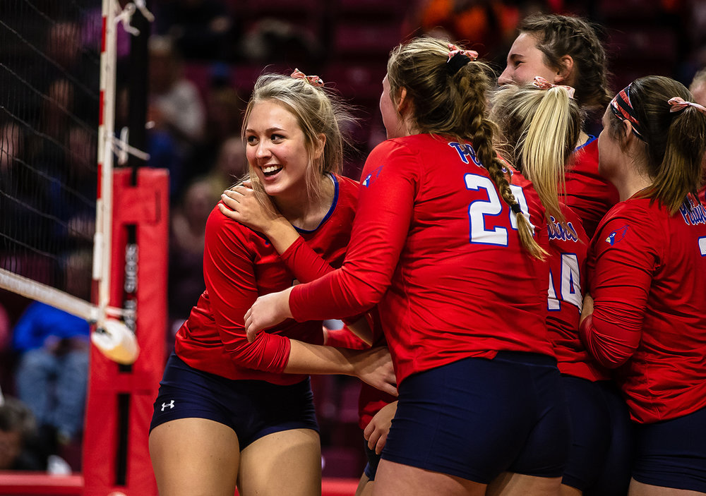 Pleasant Plains' Allie Edwards (10) is swarmed by her teammates after making the game winning play to send the Cardinals past Champaign St. Thomas More during the Class 2A IHSA Volleyball State Final Tournament semifinals at Redbird Arena, Friday, Nov. 9, 2018, in Normal, Ill. [Justin L. Fowler/The State Journal-Register]