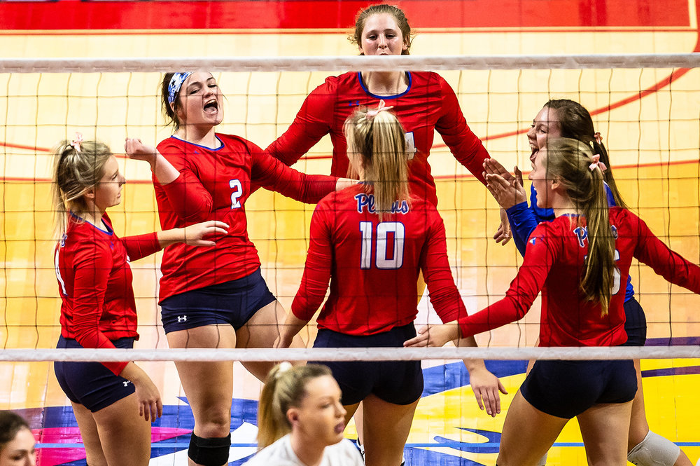 Pleasant Plains' Jade Garrett (2) and the Cardinals celebrate a point against Champaign St. Thomas More during the Class 2A IHSA Volleyball State Final Tournament semifinals at Redbird Arena, Friday, Nov. 9, 2018, in Normal, Ill. [Justin L. Fowler/The State Journal-Register]