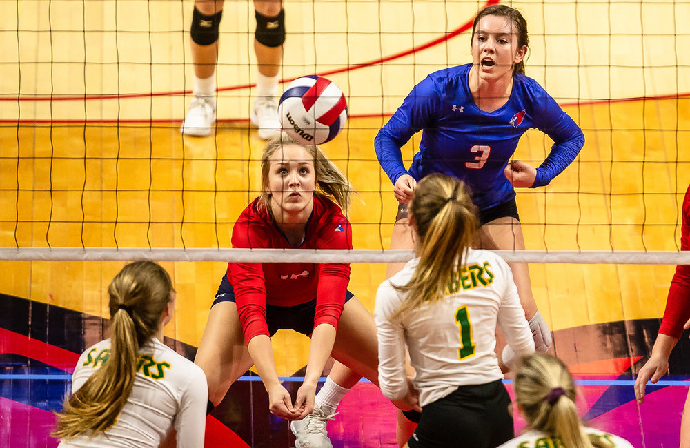 Pleasant Plains' Allie Edwards (10) digs out an attack from Champaign St. Thomas More during the Class 2A IHSA Volleyball State Final Tournament semifinals at Redbird Arena, Friday, Nov. 9, 2018, in Normal, Ill. [Justin L. Fowler/The State Journal-Register]