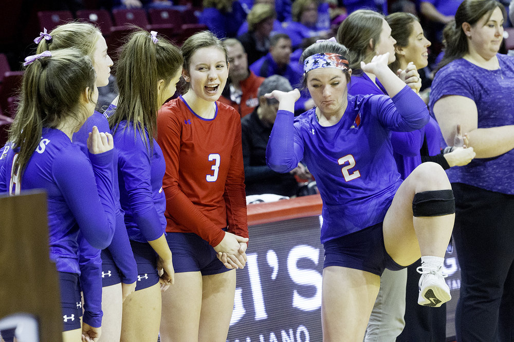 Pleasant Plains' MacKenzie Houser  laughs as teammate Jade Garrett dances on the sidelines after the Cardinals defeated Galena during the IHSA Class 2A Volleyball championship at Redbird Arena in Normal Saturday, Nov. 10, 2018. [Ted Schurter/The State Journal-Register]