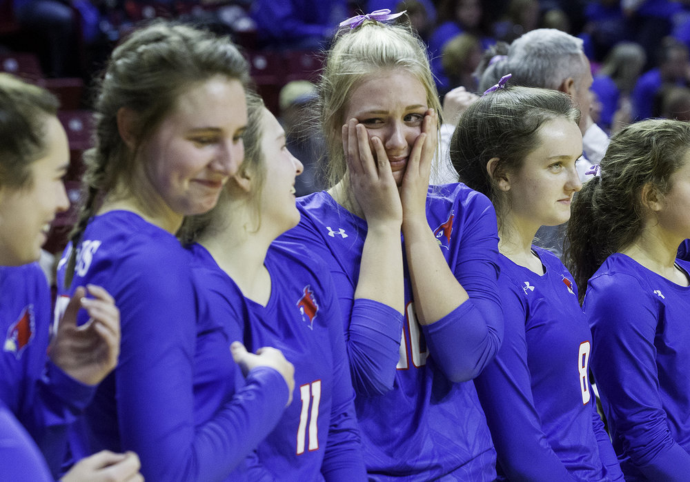Pleasant Plains' Allie Edwards  is overcome with emotion as she waits for the trophy presentation after the Cardinals defeated Galena during the IHSA Class 2A Volleyball championship at Redbird Arena in Normal Saturday, Nov. 10, 2018. [Ted Schurter/The State Journal-Register]