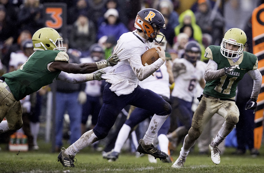 Rochester's Clay Bruno runs the ball upfield against Bishop McNamara during the Class 4A semifinal at Kankakee Bishop McNamara Saturday, Nov. 17, 2018. [Ted Schurter/The State Journal-Register]