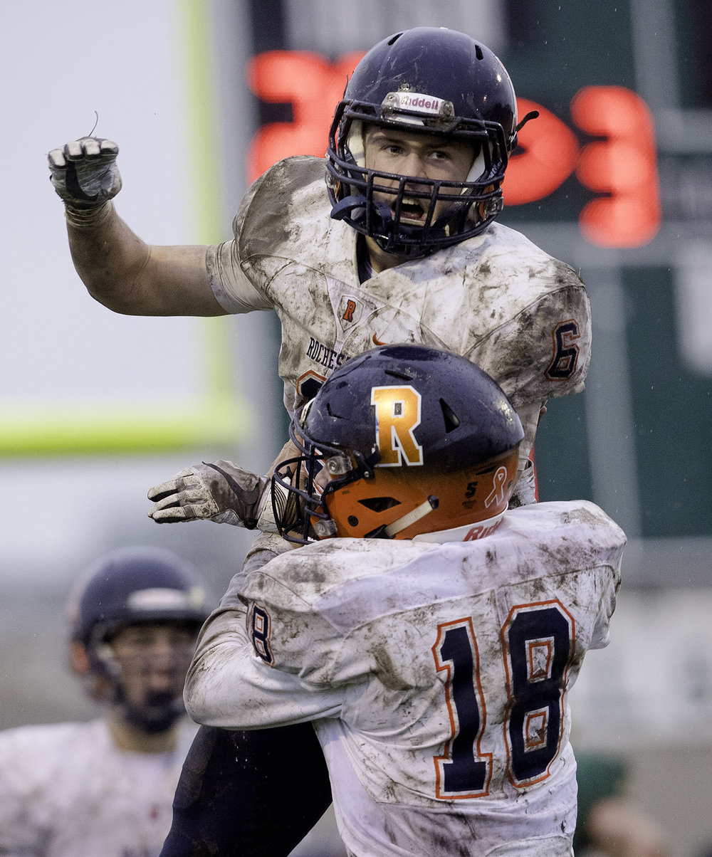 Rochester's Cade Eddington celebrates a touchdown against Bishop McNamara during the Class 4A semifinal at Kankakee Bishop McNamara Saturday, Nov. 17, 2018. [Ted Schurter/The State Journal-Register]