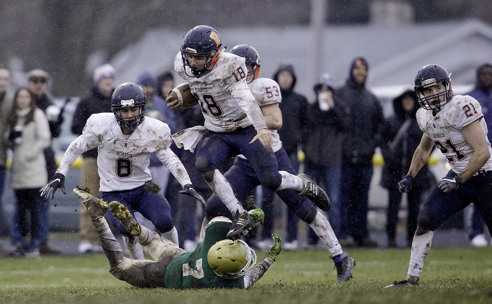 Rochester's Clay Bruno leaps a Bishop McNamara defender during the Class 4A semifinal at Kankakee Bishop McNamara Saturday, Nov. 17, 2018. [Ted Schurter/The State Journal-Register]