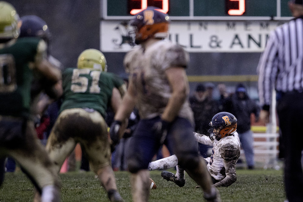 Rochester's Clay Bruno slips and falls and looses the ball in the second half during the Class 4A semifinal at Kankakee Bishop McNamara Saturday, Nov. 17, 2018. [Ted Schurter/The State Journal-Register]