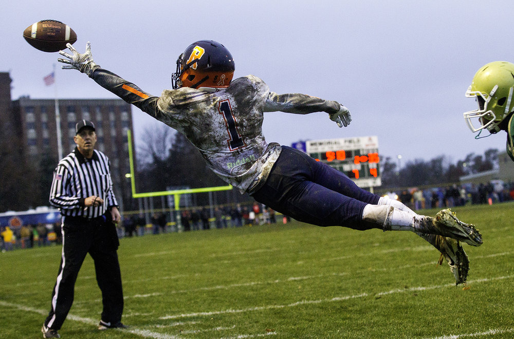 Rochester's Riley Lewis  leaps to catch a pass just out of reach during the Class 4A semifinal at Kankakee Bishop McNamara Saturday, Nov. 17, 2018. [Ted Schurter/The State Journal-Register]