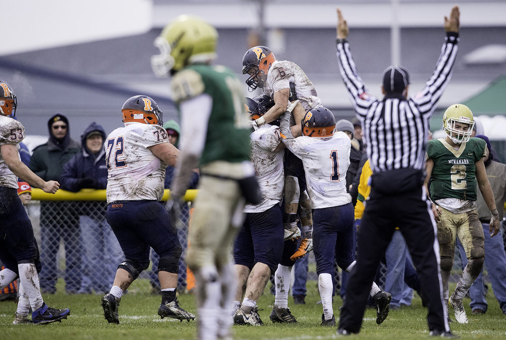 The Rochester Rockets celebrate a Cade Eddington touchdown during the Class 4A semifinal at Kankakee Bishop McNamara Saturday, Nov. 17, 2018. [Ted Schurter/The State Journal-Register]