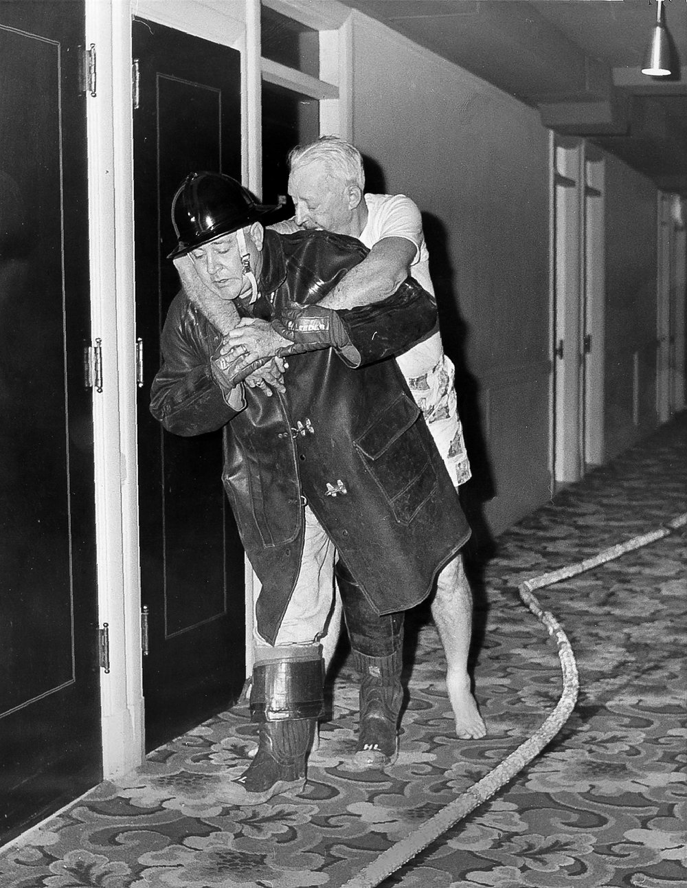 Springfield firefighter Henry Leeder carries William Winchester, suffering from smoke inhalation, from his room on the 11th floor of the Hotel St. Nicholas during a fire Nov, 6, 1961. [Bill Hagen/The State Journal-Register]
