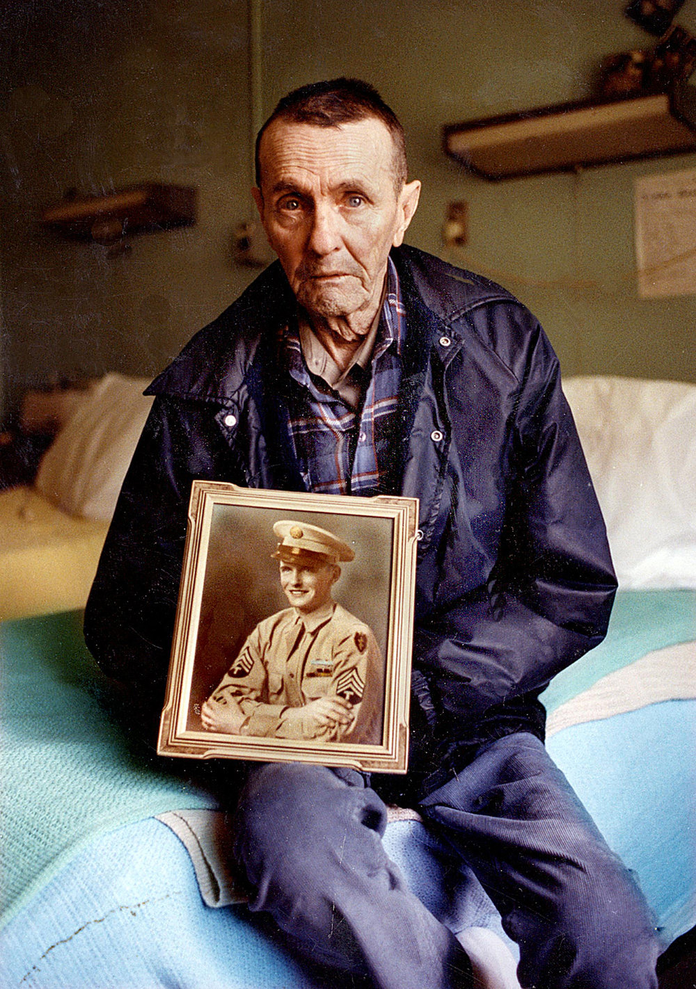 George Siegler holds a portrait of himself that was taken when he was a sergeant in the U.S. Army during World War II. Siegler's portrait was published Aug. 20, 1990 with a story on the Illinois Veterans Home in Quincy. [Bill Hagen/The State Journal-Register]