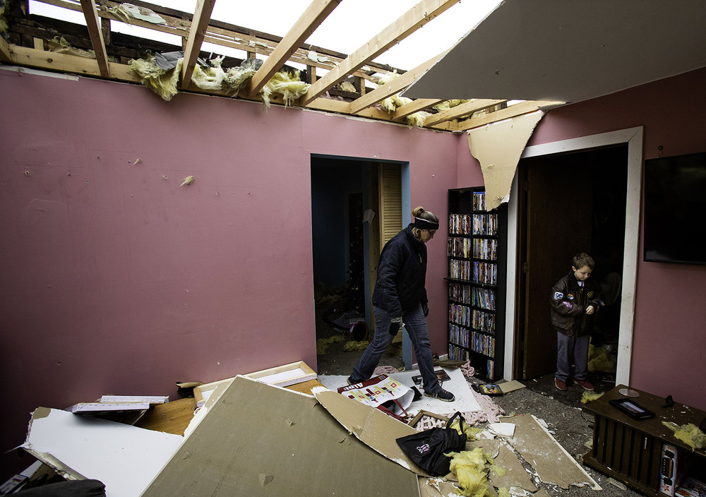 Tammy Bowers and her son David gather a few items from the interior of their tornado damaged Taylorville home Sunday, Dec. 2, 2018. The roof of their home was completely torn off by the storm. [Ted Schurter/The State Journal-Register]