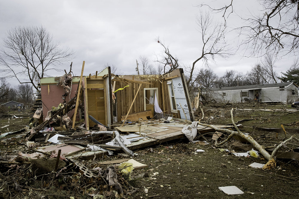 The interior of a home is visible the day after a tornado blew it off it's foundation in Taylorville Sunday, Dec. 2, 2018. [Ted Schurter/The State Journal-Register]