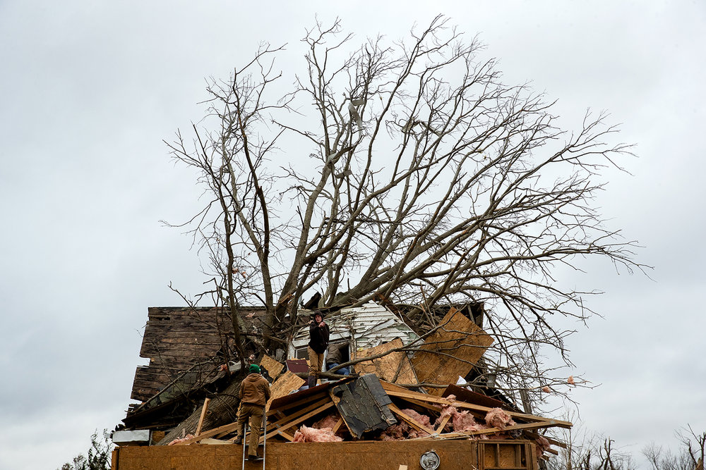 Friends and family help remove belongings from the second story of the tornado-damaged Taylorville home of Chris and Dennis Metsker Sunday, Dec. 2, 2018. [Ted Schurter/The State Journal-Register]