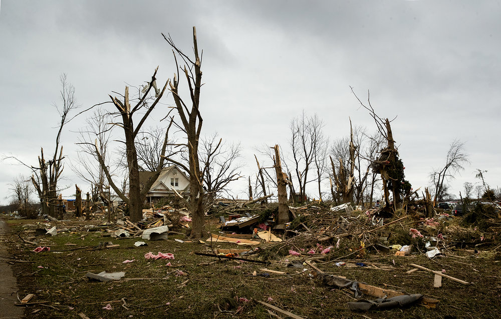 Homes and trees alike were damaged along South Houston Street in Taylorville after Saturday's tornado. [Ted Schurter/The State Journal-Register]