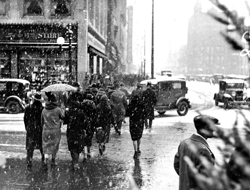 Christmas season shoppers cross Adams Street at Fifth Street, looking north. Illinois National Bank, Orpheum Theater marquee in background right, Kresge building at left. Dec. 18, 1930. File/The State Journal-Register