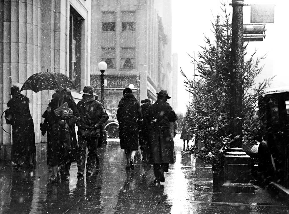 Christmas season shoppers on Fifth Street from Adams, First National Bank building on left, Kresge building in background, Dec. 18, 1930. File/The State Journal-Register