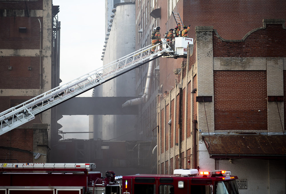 Springfield firefighters extinguished a blaze inside the former Pillsbury plant at 15th and Phillips streets Friday, Nov. 30, 2018  in Springfield, Ill. [Rich Saal/The State Journal-Register]