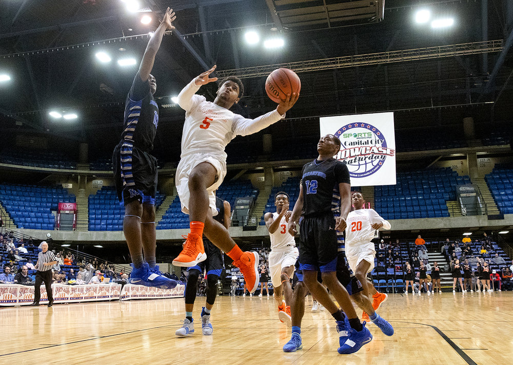 Lanphier's Stanley Morgan  drives to the hoop against MacArthur during the Capital City Showcase Saturday at the Bank of Springfield Center Saturday, Dec. 1, 2018. [Ted Schurter/The State Journal-Register]