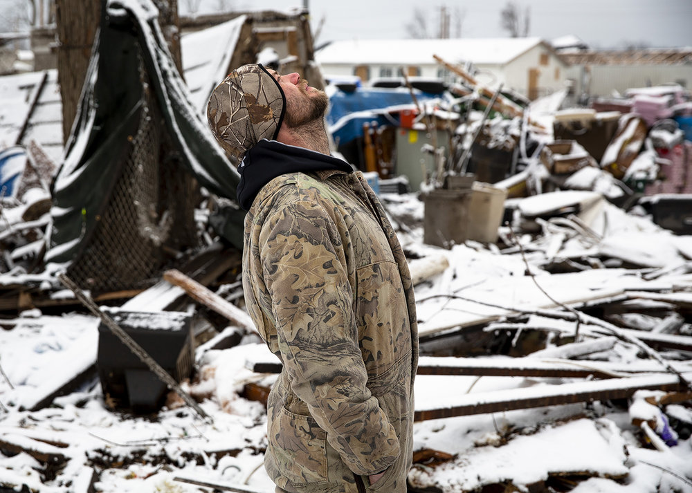 """Steven Tirpak reflected on the complete loss of his home on West Coal Street in Taylorville Thursday, Dec. 6, 2018, after a tornado stuck the unincorporated community of Hewittville near Taylorville the previous Saturday. """"How much more can a daddy take?"""" Tirpak, a single father, said through tears. """"I've always worked and provided for my family. I want to rebuild. That was a home I worked hard for."""" [Rich Saal/The State Journal-Register]"""