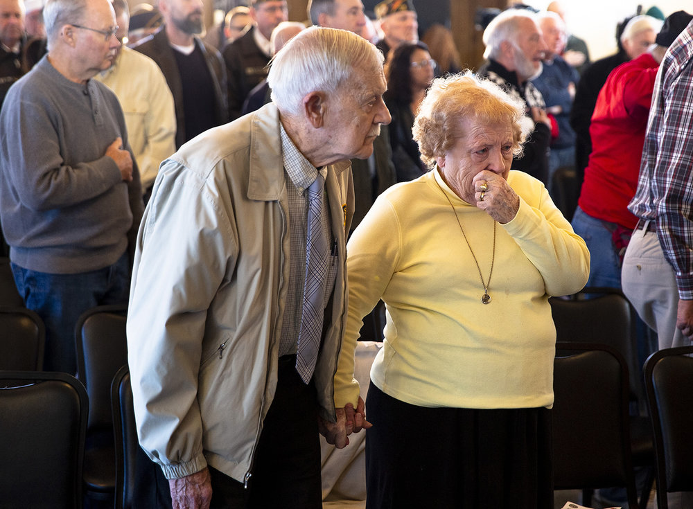 Eunice Goode is overcome with emotion when she recalls her childhood friend, a Japanese girl, who was taken away by soldiers one day in her native England after the Japanese bombed Pearl Harbor. Goode, who later served in a support role during the war for the Royal Air Force, never saw her friend again. Goode attended the Pearl Harbor Remembrance Day ceremony Friday, Dec. 7, 2018 at the Springfield Elks Lodge in Springfield, Ill. with her husband, James, left. James is a veteran of the Korean War. [Rich Saal/The State Journal-Register]