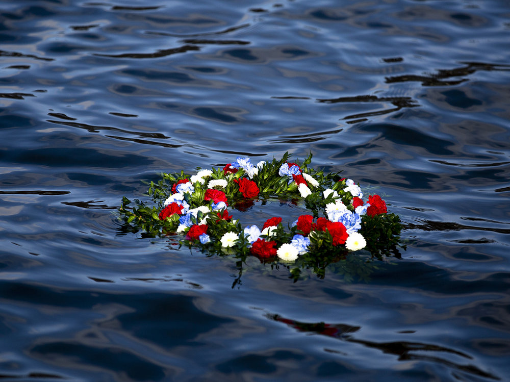 A wreath laid by the daughters of Pearl Harbor survivor Carl Browning, floats in the waters of Lake Springfield during the Pearl Harbor Remembrance Day ceremony Friday, Dec. 7, 2018 at the Springfield Elks Lodge in Springfield, Ill. [Rich Saal/The State Journal-Register]