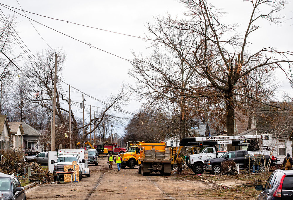 The cleanup work continues from Saturday's tornado continues along West Prairie Street, Monday, Dec. 3, 2018, in Taylorvile, Ill. [Justin L. Fowler/The State Journal-Register]