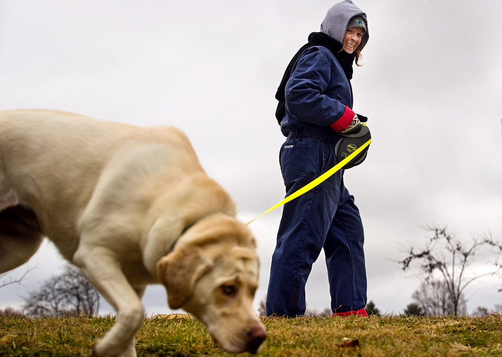 Debby Guimard bundled up heavily to get her daily one mile walk in with her two-year-old labrador retriever Mya in the near freezing temperatures Tuesday, Dec. 4, 2018. [Ted Schurter/The State Journal-Register]