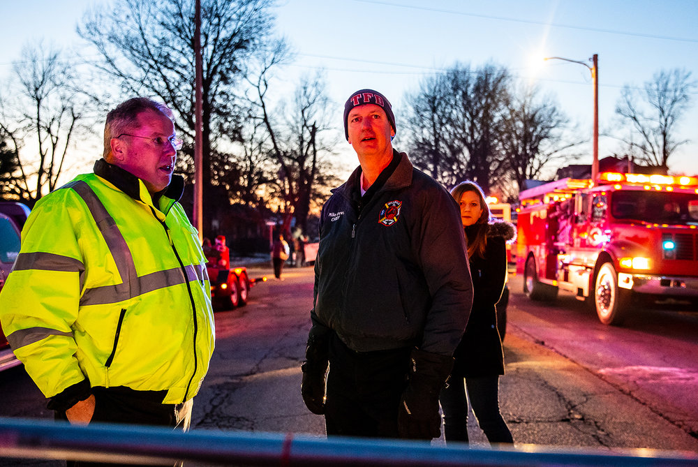 Taylorville Fire Chief Mike Crews, right, and Taylorville Mayor Bruce Barry, left, get ready to march in the redo of the Taylorville Christmas Parade, Saturday, Dec. 8, 2018, in Taylorville, Ill. The parade was set to step off last Saturday and was cancelled right before a tornado hit the town. [Justin L. Fowler/The State Journal-Register]