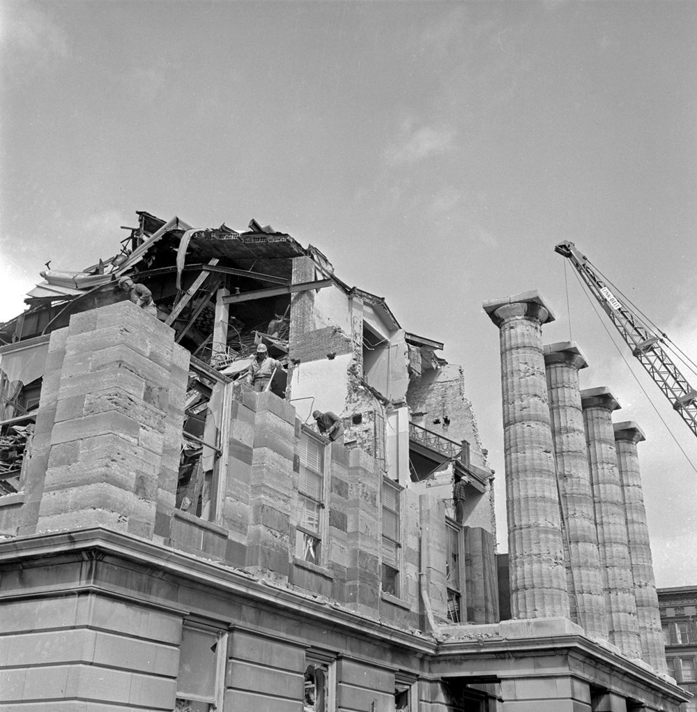 Workers remove the exterior stone from the Old State Capitol in March, 1966. File/The State Journal-Register