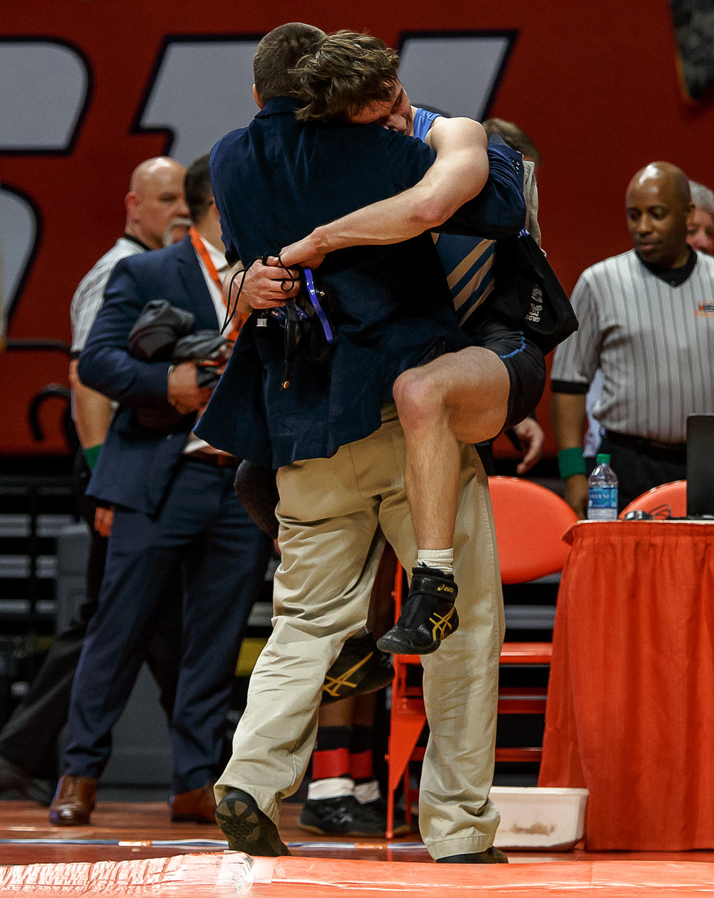 Petersburg PORTA's Trey Hild jumps into the arms of his father Davey Hild after defeating Quincy Notre Dame's Zach Haley during the IHSA Class 1A State Wrestling Tournament 145-pound championship match at the State Farm Center, Saturday, Feb. 17, 2018, in Champaign, Ill. [Justin L. Fowler/The State Journal-Register]