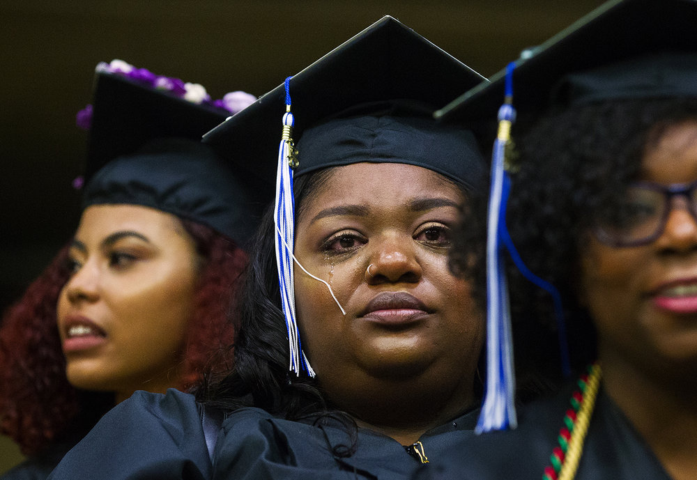 Tears roll down Faith Edwards' face during the processional for the 47th annual UIS commencement ceremonies at the Bank of Springfield Center on Saturday, May 12, 2018. [Ted Schurter/The State Journal-Register]