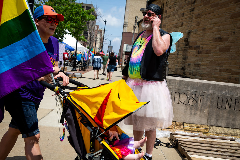 Stephen Trout of Decatur directs a friend to the corner of Fourth Street and Capitol Avenue during Springfield's PrideFest street party Saturday, May 19, 2018 in Springfield, Ill. [Rich Saal/The State Journal-Register]