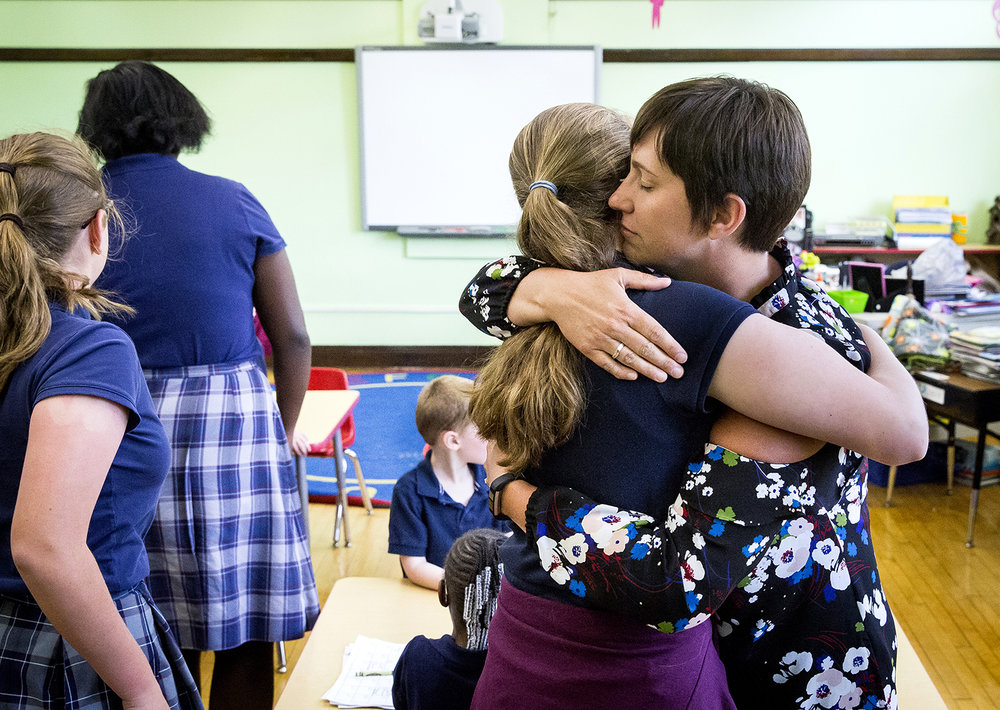 Brandi Harbert has a long hug for Alexandra Blake when she stopped by Harbert's pre-kindergarten classroom at the Cathedral Grade School to say goodbye Tuesday, May 22, 2018 in Springfield, Ill. Blake and her fellow seventh graders went room to room to greet each teacher on the school's final day open. The parish announced earlier this year the school would close for good, due to declining enrollment. [Rich Saal/The State Journal-Register]