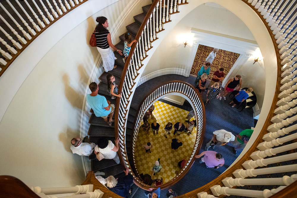 Guests and visitors make their way up the spiral grand staircase during public tours at the grand reopening of the Illinois Governor's Mansion on East Jackson Street in Springfield, Ill., Saturday, July 14, 2018. [Ted Schurter/The State Journal-Register]