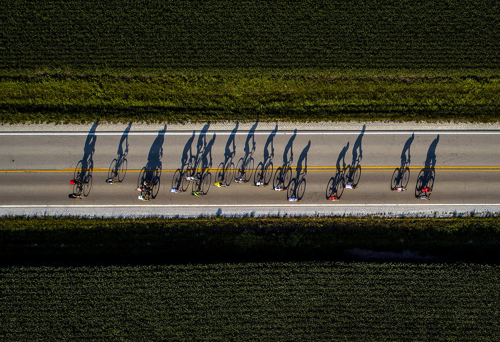 Bicyclists cast long shadows during a weeknight group ride near Pleasant Plains June 25. [Justin L. Fowler/The State Journal-Register]