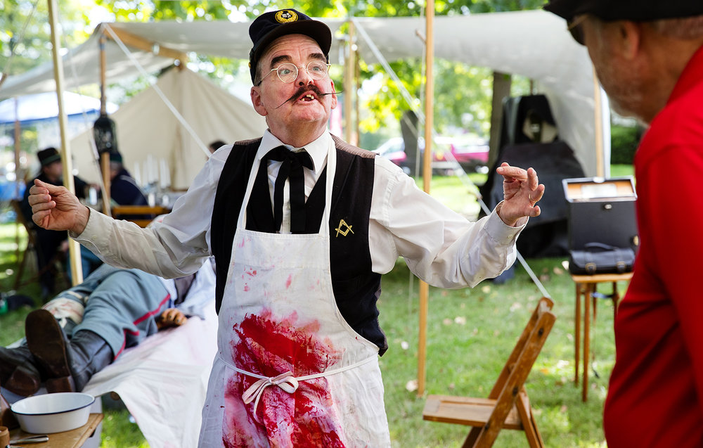 Bill Huber, a volunteer with the 108th Illinois Infantry Field Hospital who said he spent six months growing his period mustache, discusses Civil War medical practices during the Abraham Lincoln National Railsplitting Festival at the Postville Courthouse in Lincoln Saturday, Sept. 15, 2018. The multi-site festival continues Sunday with live music, railsplitting competitions, working crafts, food and more. [Ted Schurter/The State Journal-Register]