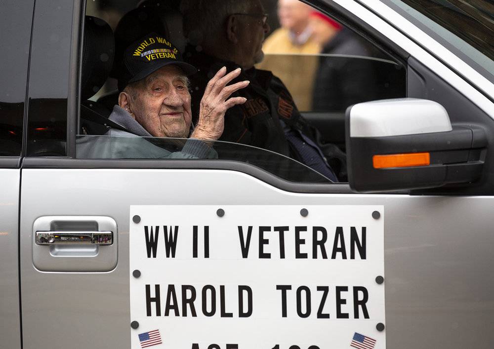 Harold Tozer, 102 years-old and a World War II veteran, waves to people watching the Veterans Day parade Monday, Nov. 12, 2018 on Capitol Avenue in Springfield, Ill. [Rich Saal/The State Journal-Register]