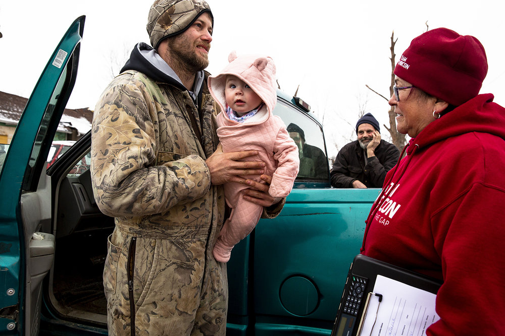 Steven Tirpak introduces his daughter Zayanna, 6 months-old, to Sharon Sinklair Thursday, Dec. 6, 2018 outside the lot where his home on Coal Street in Taylorville, Ill. stood until it was destroyed by a tornado on Saturday. The Tirpaks are living with his aunt in Stonington. Sinklair is with Team Rubicon, an organization that coordinates military veterans to help with recovery efforts during natural disasters. [Rich Saal/The State Journal-Register]