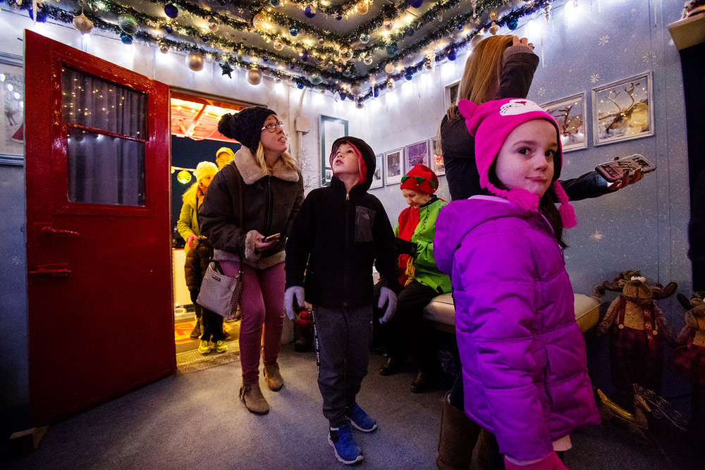 Gage Campbell glances up at the decorated ceiling of the Santa Claus car as he and his mom Holly tour the Kansas City Southern Holiday Express during its stop in Jerseyville Monday, Dec. 10, 2018.  The train, a festive, six-car train that brings Santa Claus and his elves to communities throughout the company's U.S. rail network at scheduled stops, is free, open to the public and no tickets are required. [Ted Schurter/The State Journal-Register]