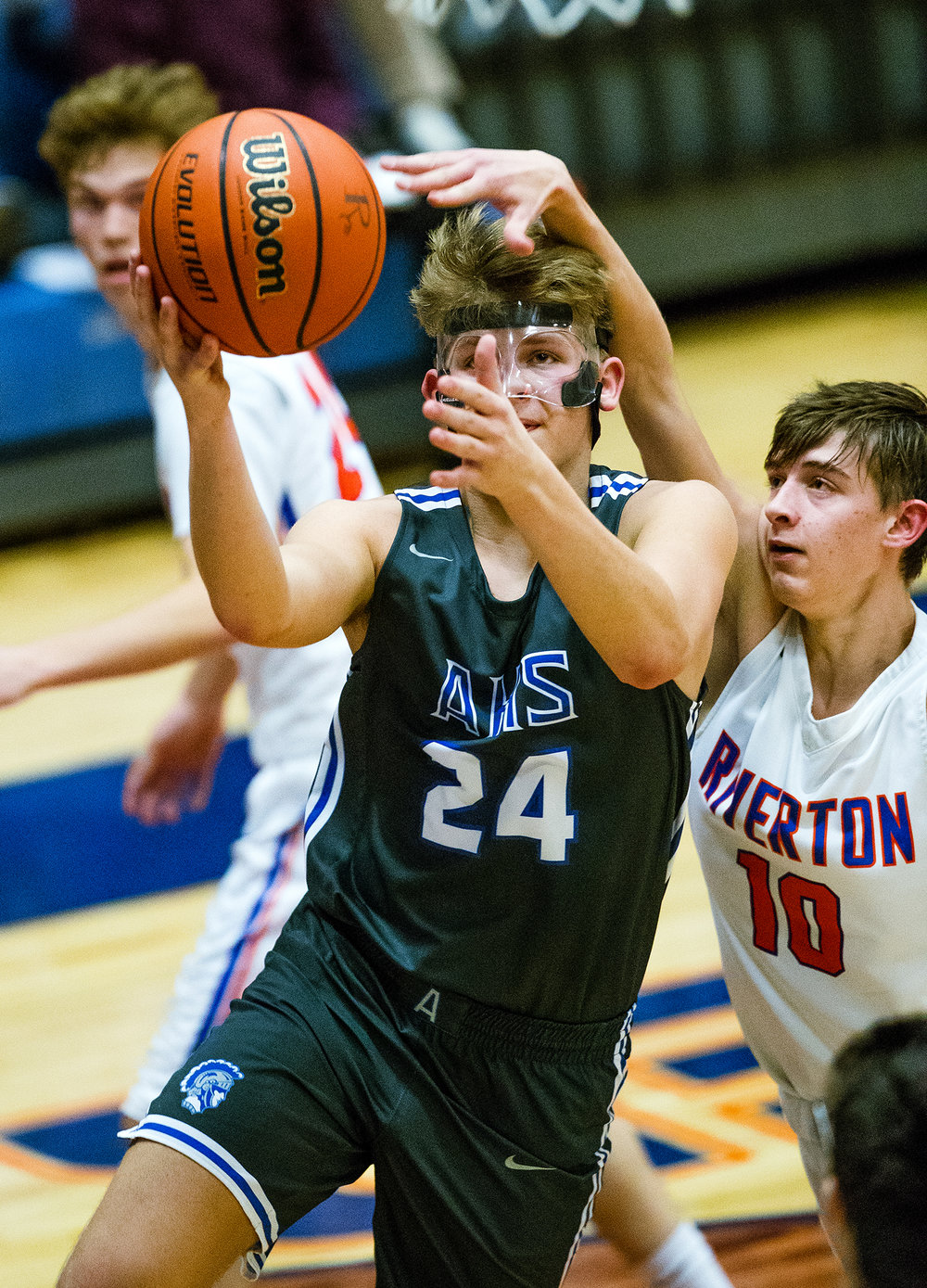Auburn's Luke Hunley drives to the hoop past Riverton's Dayton Durham at Riverton High School Tuesday, Dec. 18, 2018. [Ted Schurter/The State Journal-Register]